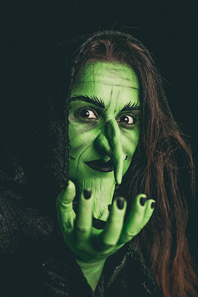 Evil witch holding an invisible item - foto de stock