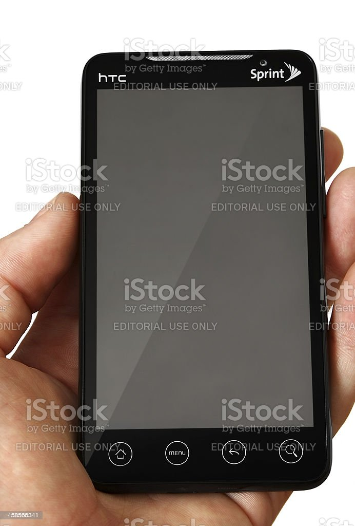 HTC Evo in hand isolated on white royalty-free stock photo