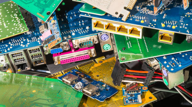 E-waste pile from discarded computer parts stock photo