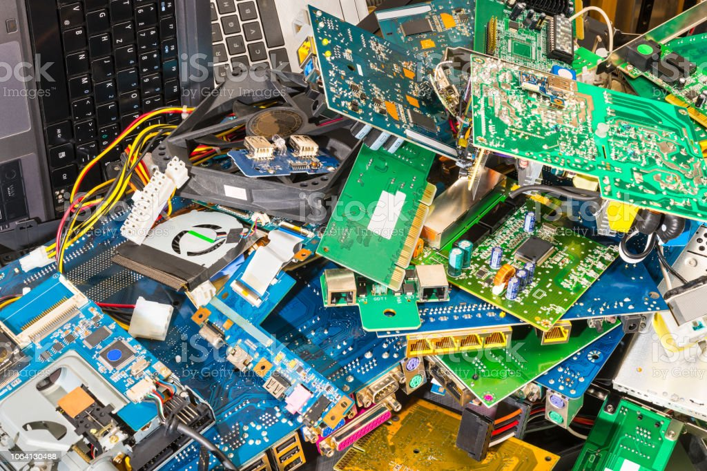 E-waste pile from discarded laptop parts stock photo