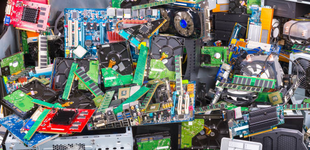 E-waste sorting, recycling and disposal. Used computer parts. Electronic, plastic and metal refuse stock photo