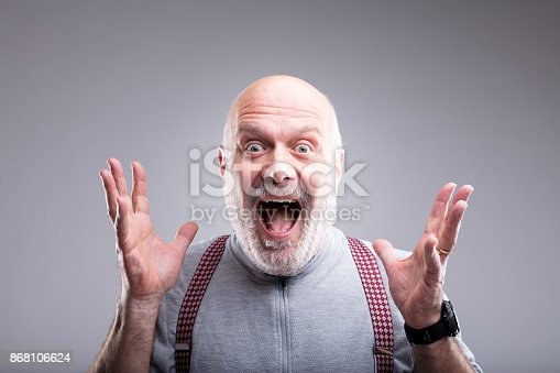 istock exaggerated surprise of an old man 868106624