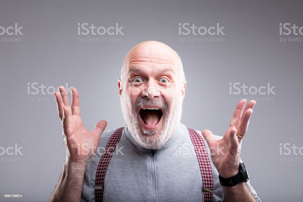 exaggerated surprise of an old man stock photo