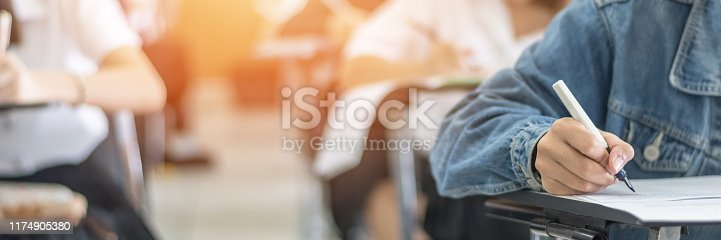 963192098 istock photo Exam at school with student's taking educational admission test in class, thinking hard, writing answer in university classroom, education and world literacy day concept 1174905380