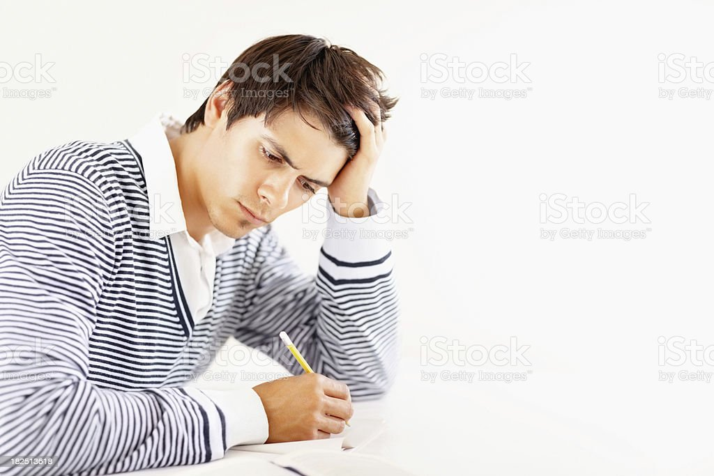 Exam pressure - Young student studying for the exams royalty-free stock photo