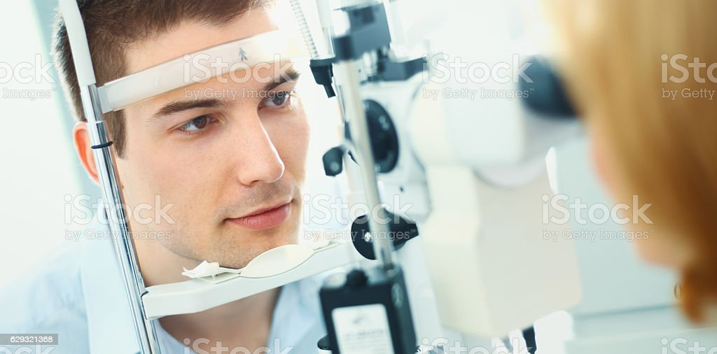 Examination at optician's offfice. stock photo