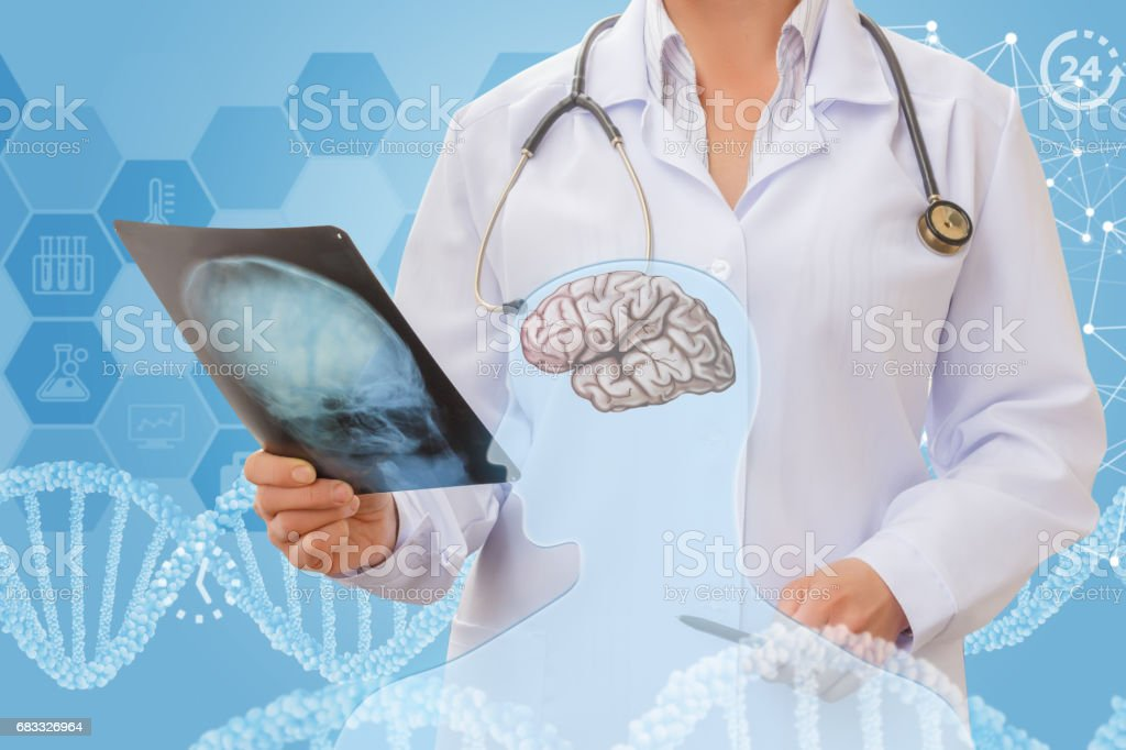 Examines the skull of the patient. royalty-free stock photo