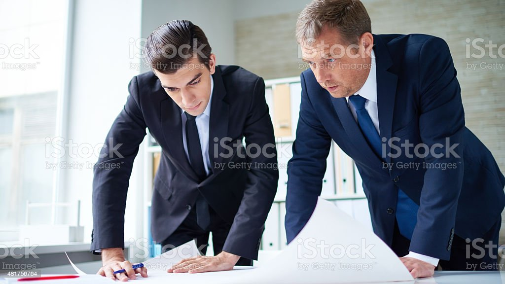 Examining a plan stock photo