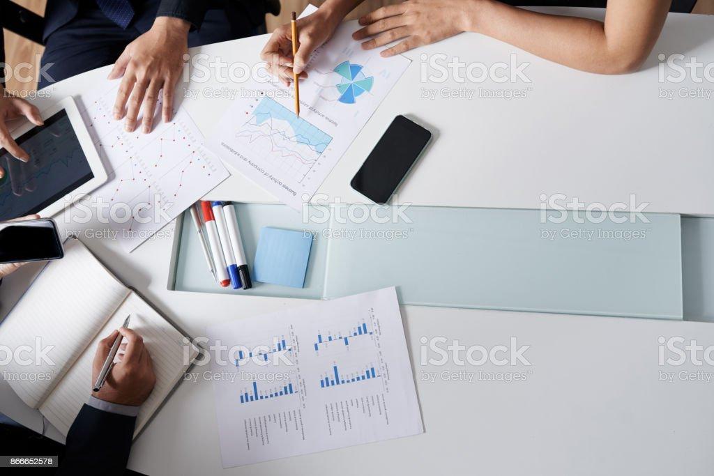 Examining annual report stock photo