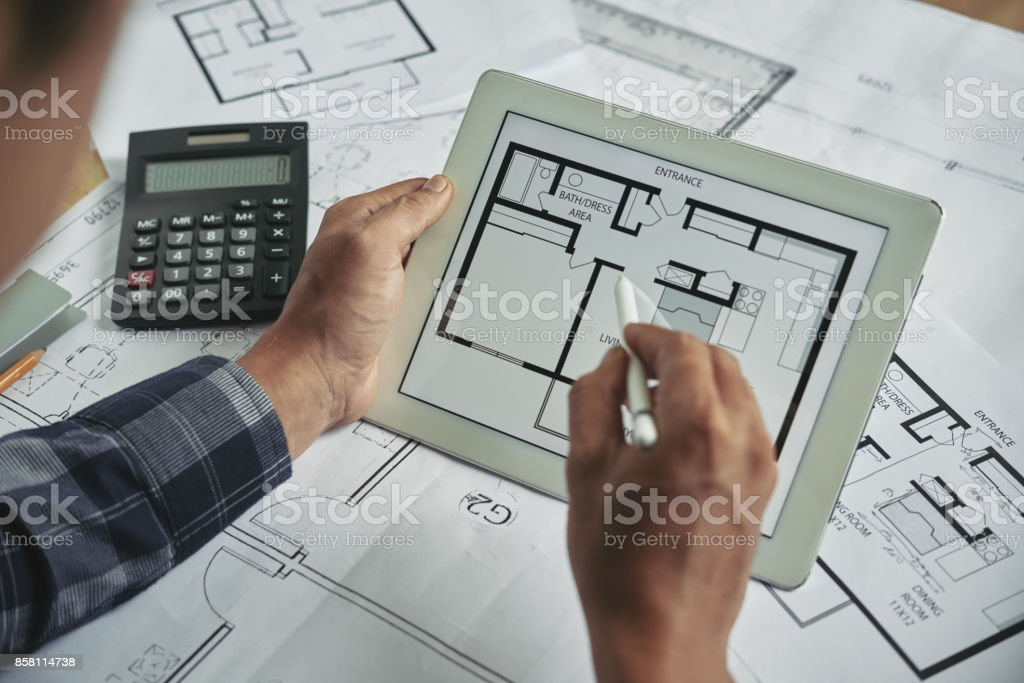 Examining blueprint stock photo