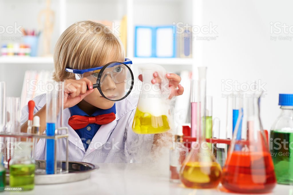 Examining fuming acid stock photo