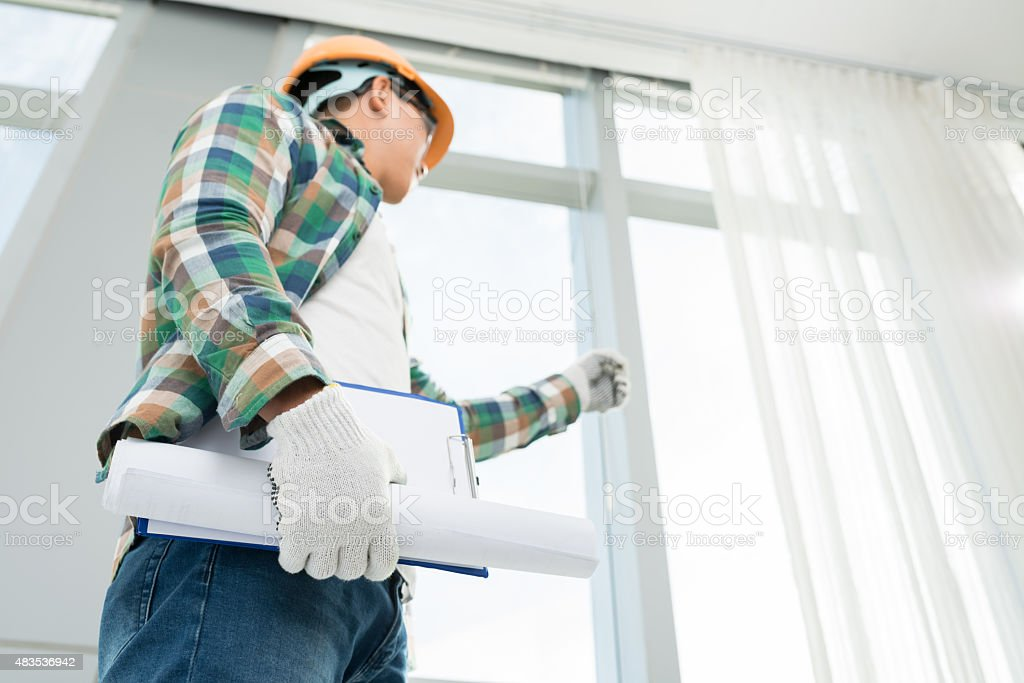 Examining house stock photo