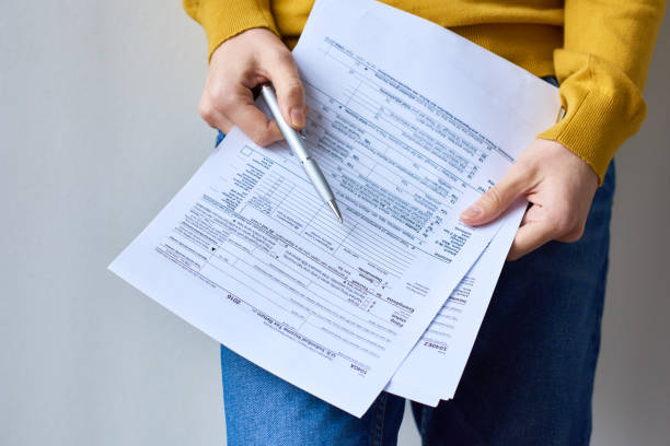 Examining individual income tax return document stock photo
