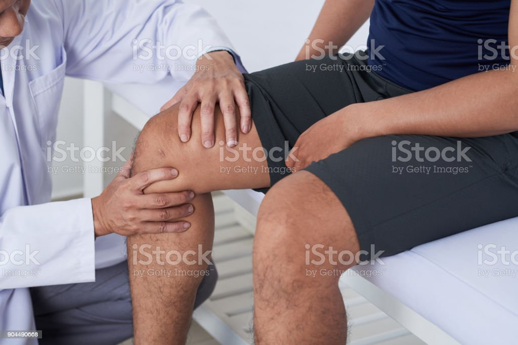 Examining knee stock photo