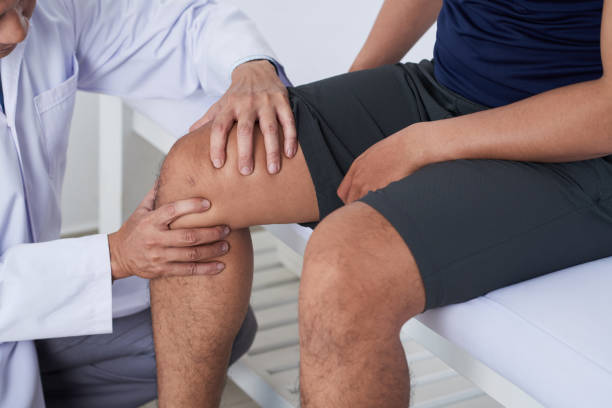 examining knee - sports medicine stock photos and pictures