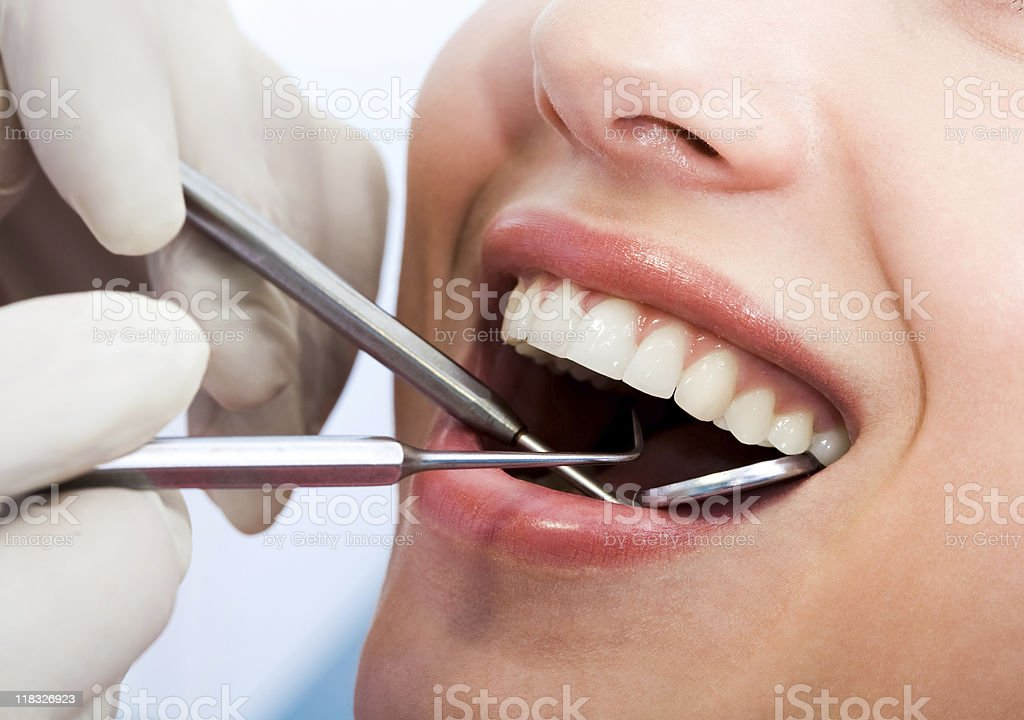 Examining mouth stock photo