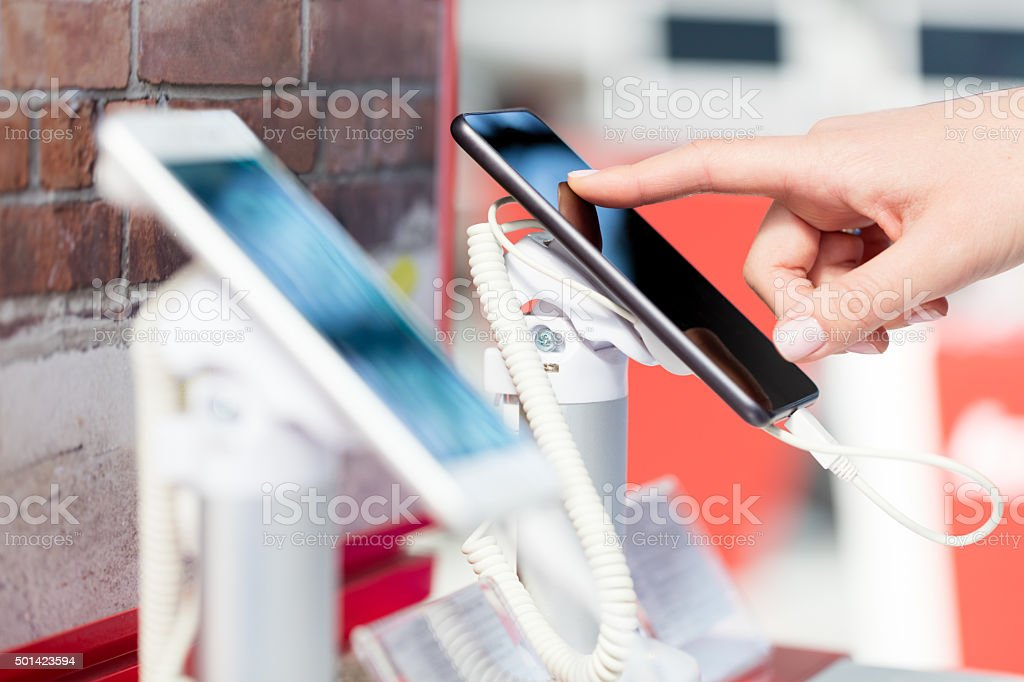 Examining new smart phone stock photo