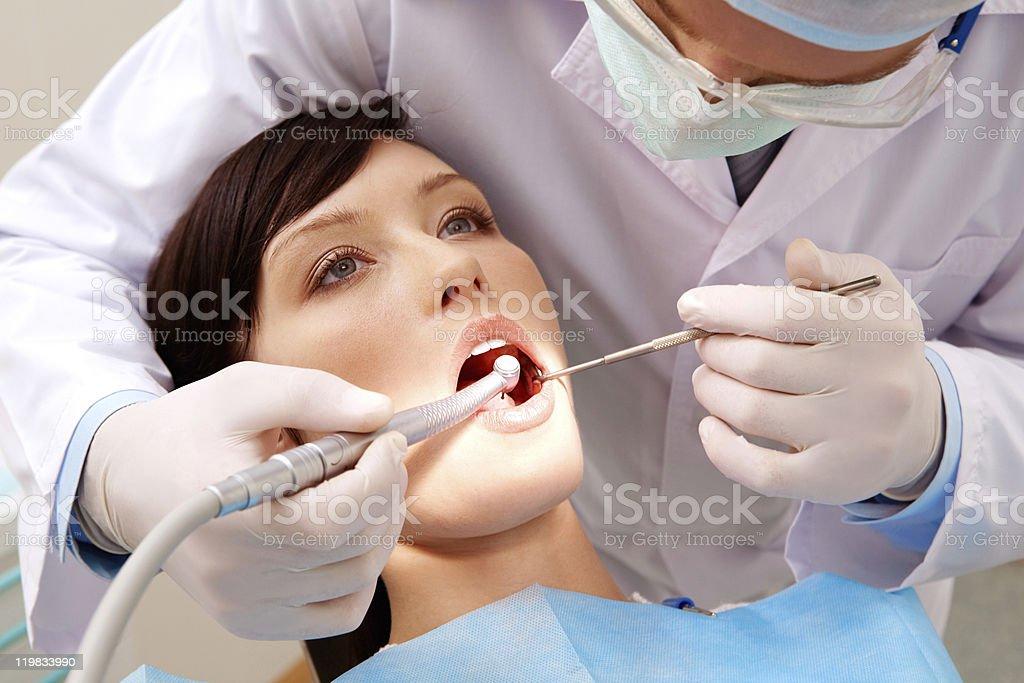 Examining oral cavity royalty-free stock photo