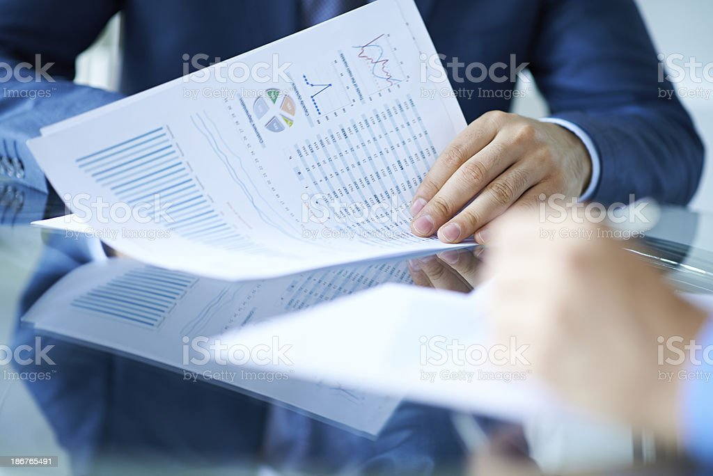 Examining report stock photo