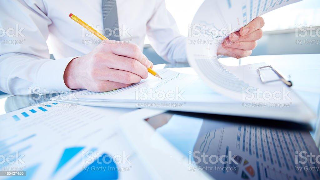 Examining report stock photo