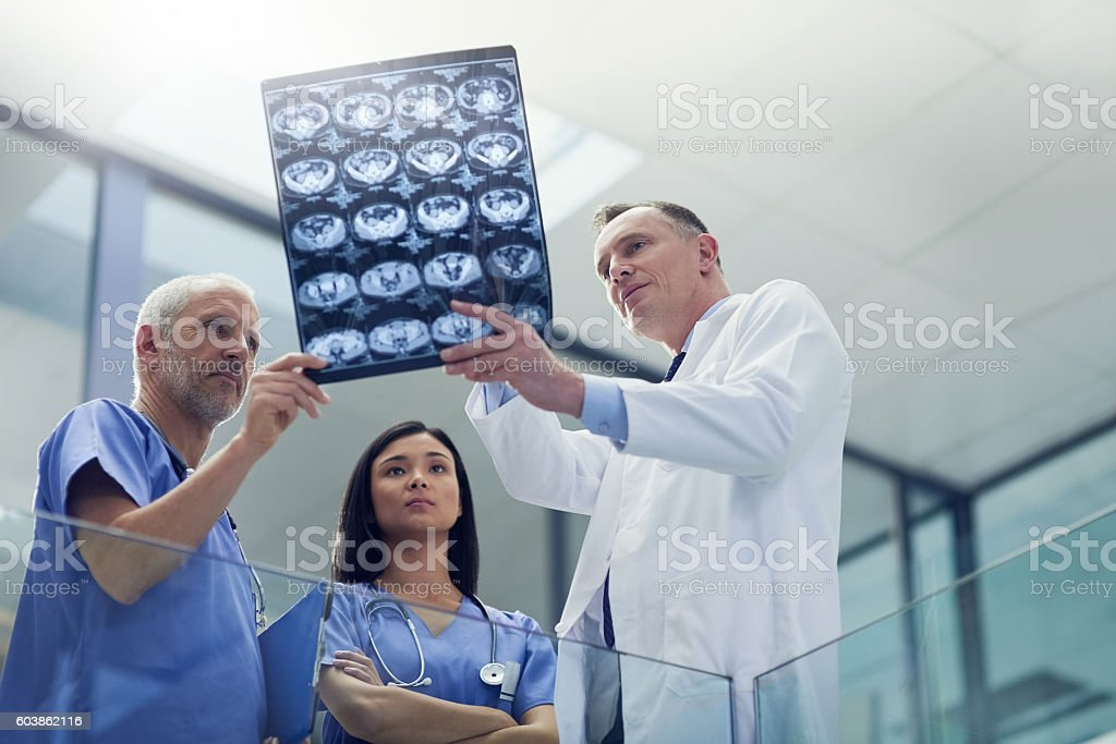Examining the patient's latest scans stock photo