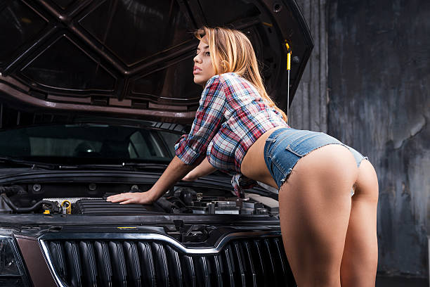 examining your car. - rear view stock photos and pictures