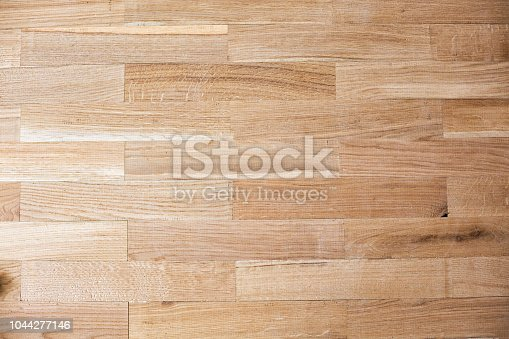 922081754istockphoto Example of assembled parquet flooring 1044277146