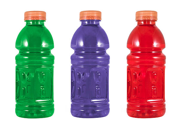 Example of different colored sports drinks stock photo