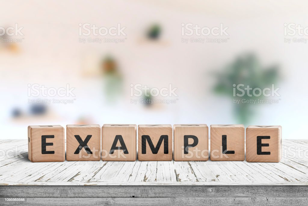 Example sign on a wooden table in a bright room stock photo