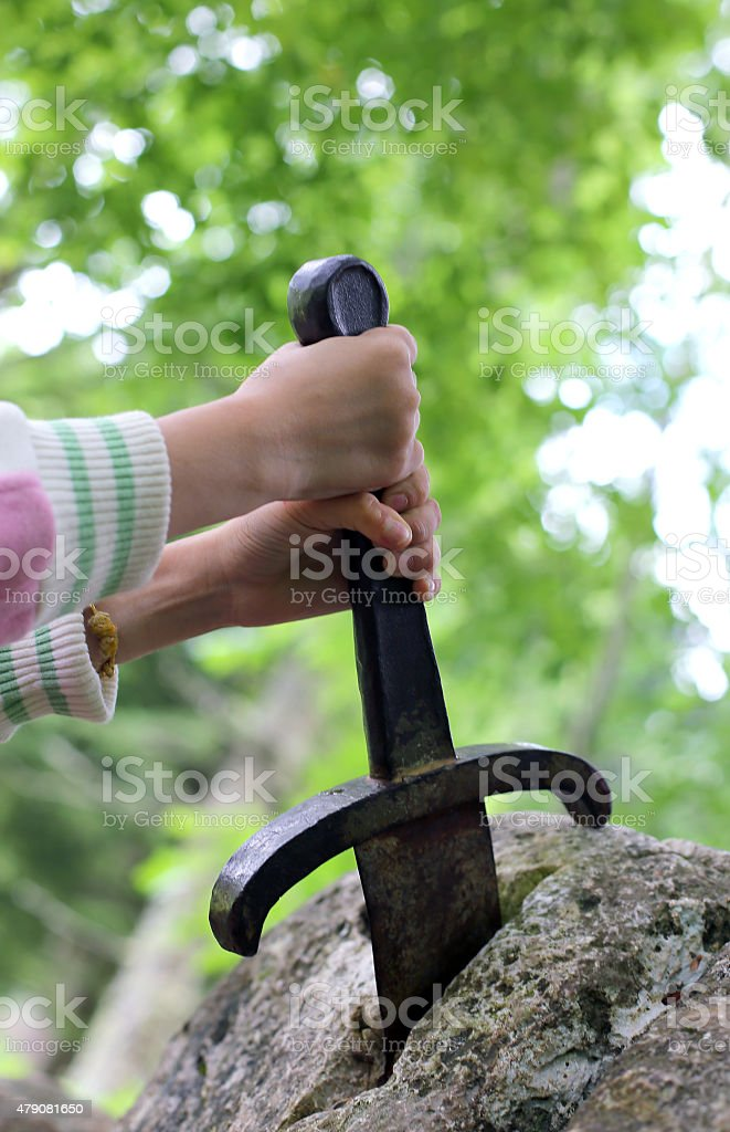 excalibur the famous sword in the stone of king Arthur stock photo