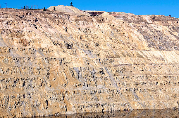 Excavated layers of surface copper mine in Montana stock photo