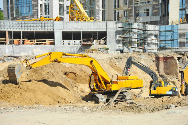 Excavating machine on construction site stock photo