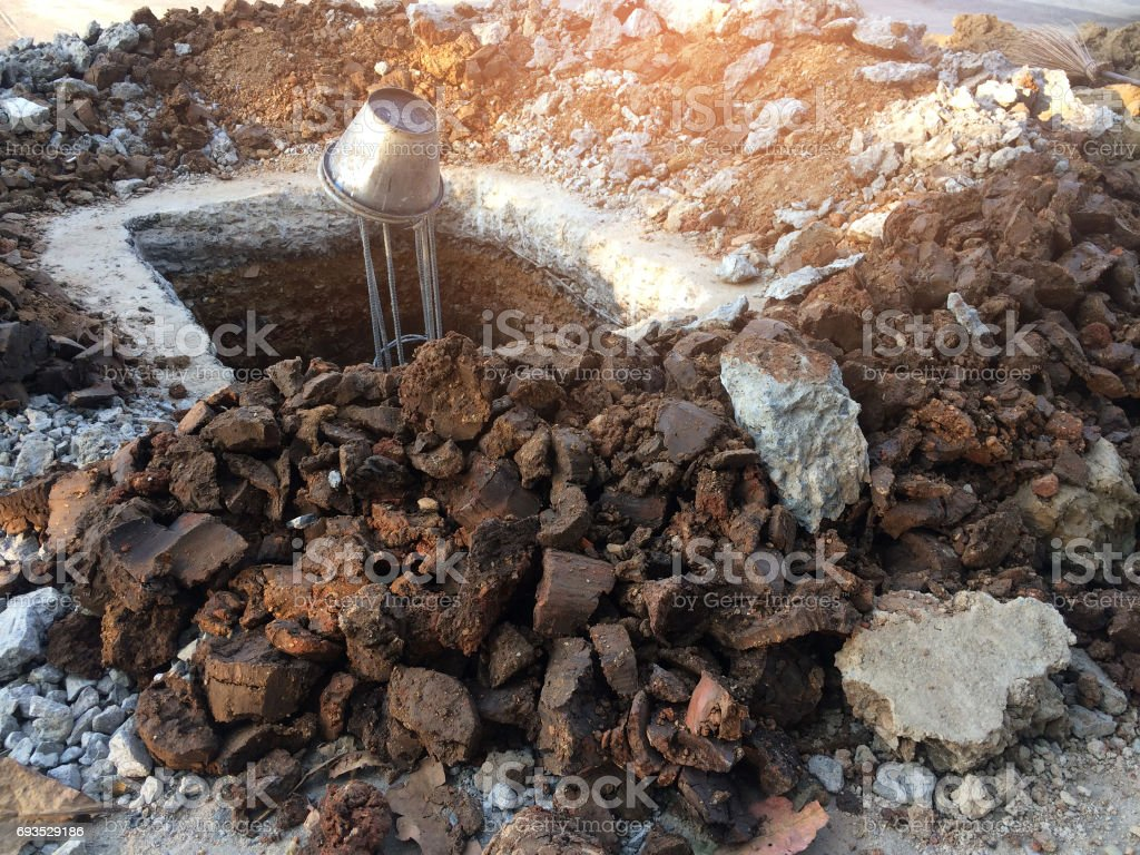 Excavation of iron-clay pits for post construction. stock photo