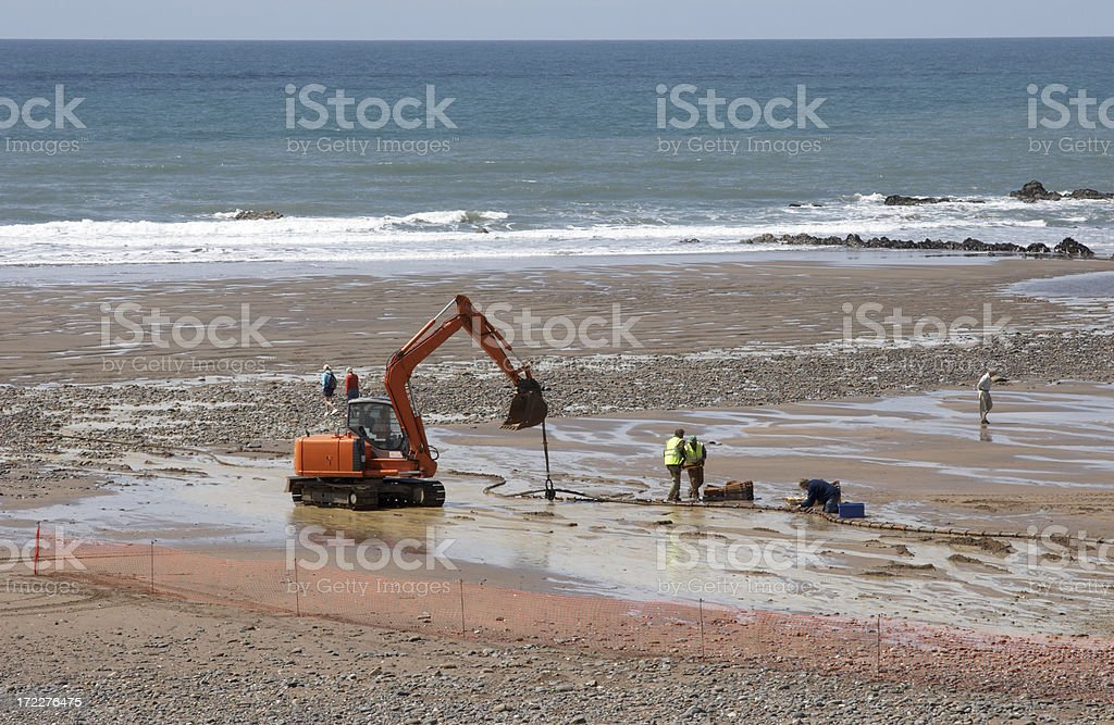 Excavation on Cornish beach royalty-free stock photo