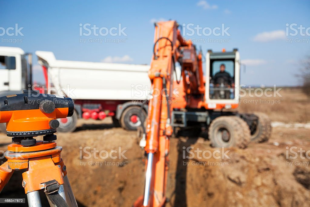 Excavator and  Instrument of Measurement royalty-free stock photo