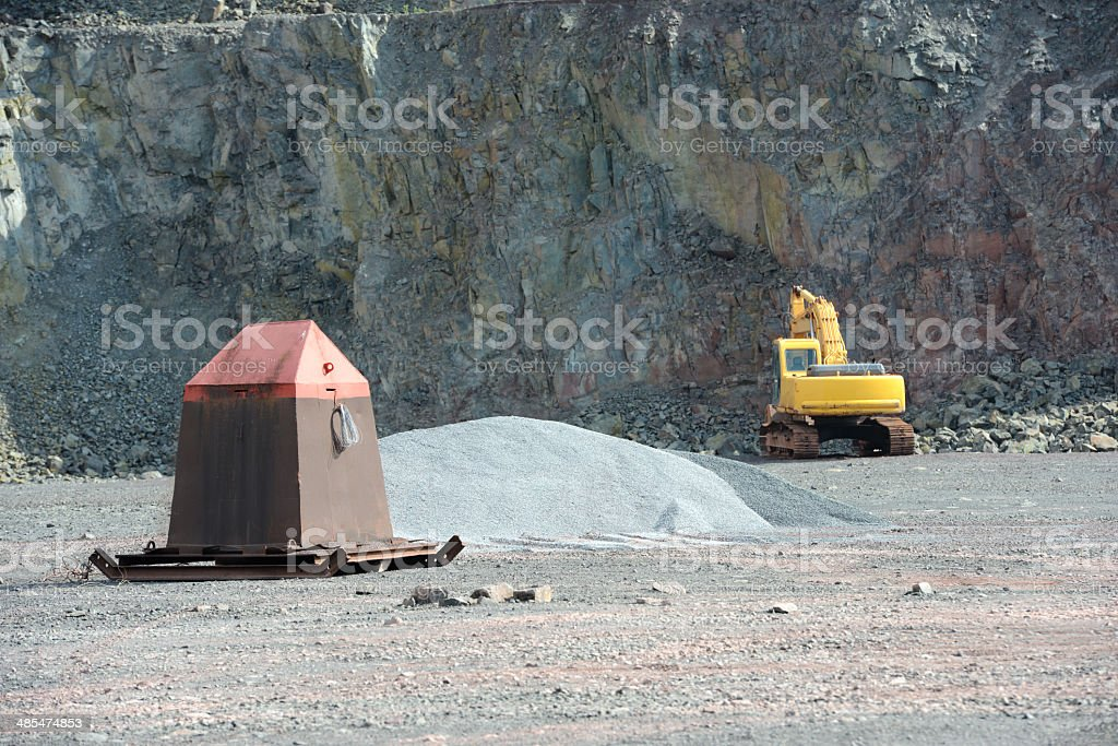 Excavator and metal refuge in a quarry in quarry royalty-free stock photo