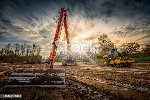 excavator and road roller with spikes
