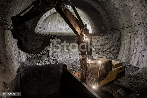 Excavator and truck for construction in tunnel