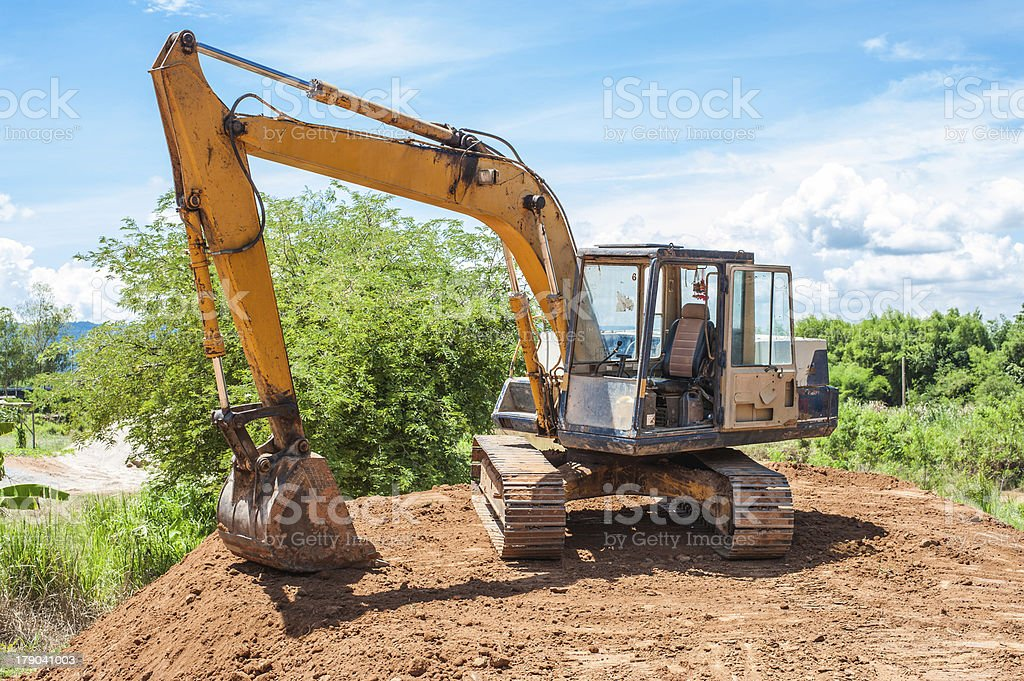 Excavator and Workers Working on Construction Site stock photo