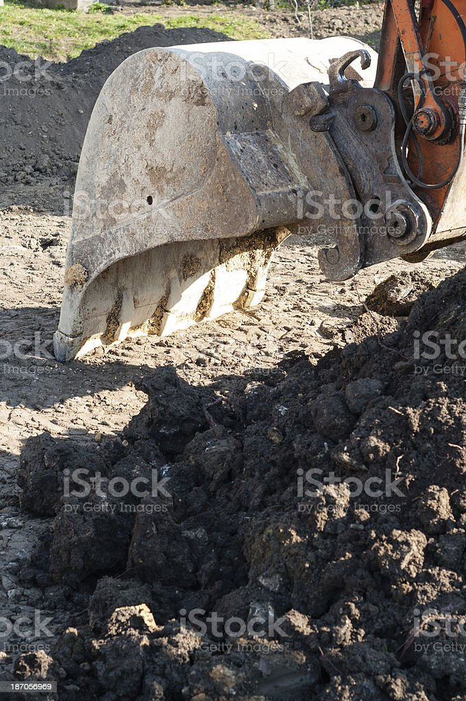 Excavator at construction on the building site royalty-free stock photo
