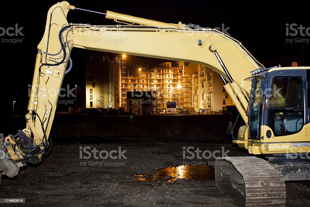 Excavator at night stock photo