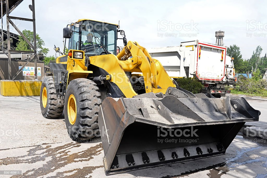Excavator at parking lot stock photo