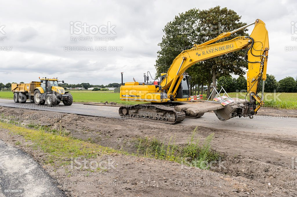 Excavator at work on the road royalty-free stock photo