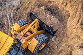 istock excavator at work 1060428268