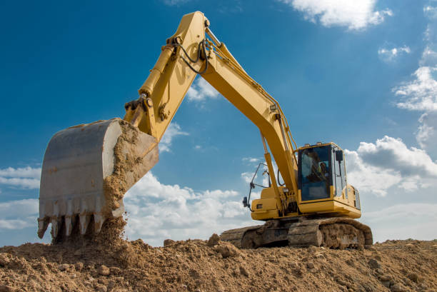 excavator blue sky heavy machine construction site stock photo