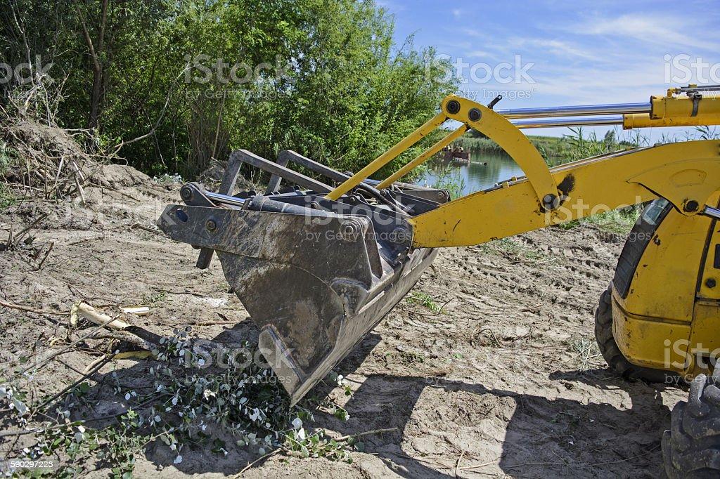 Excavator bucket clean ground royaltyfri bildbanksbilder