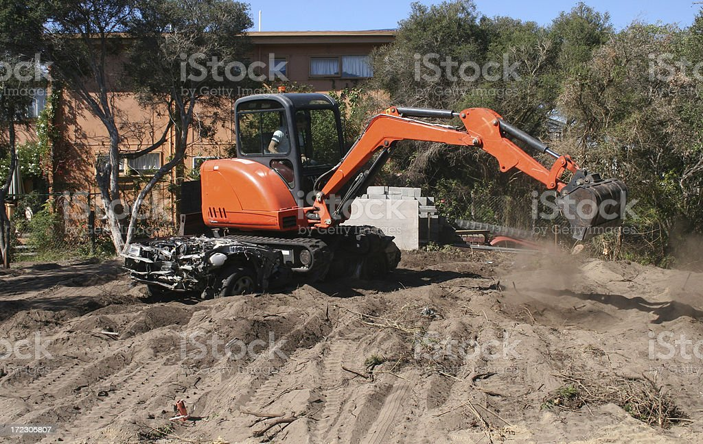 Excavator clearing land and digging royalty-free stock photo
