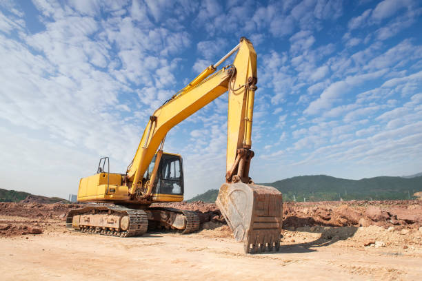 excavator digger on gravel construction site stock photo