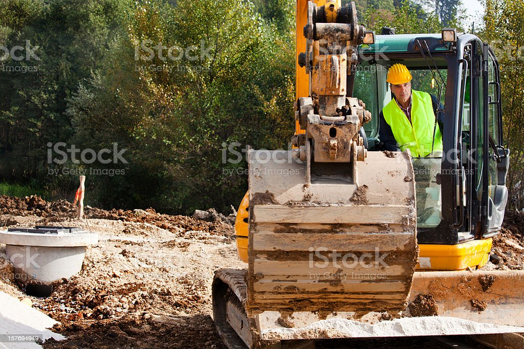 Excavator Driver on a Construction Site stock photo