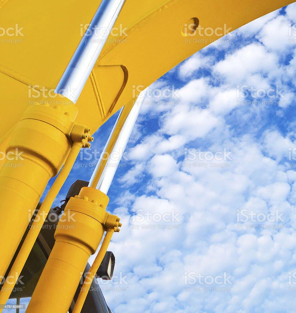 Excavator hydraulic cylinders (isolated) stock photo